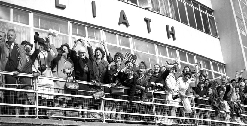 Enthusiastic onlookers wave to JFK from a packed balcony at Dublin Airport. (NLI, Independent Newspapers Collection)