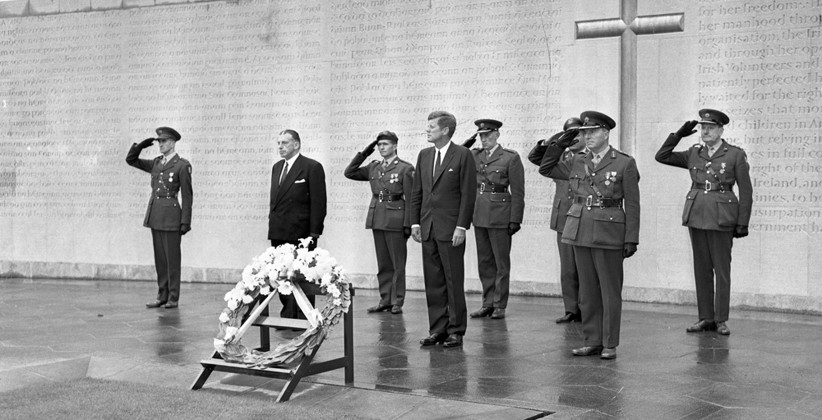 Members of the army salute as JFK stands to attention, during the Arbour Hill ceremony. (NLI, Independent Newspapers Collection)