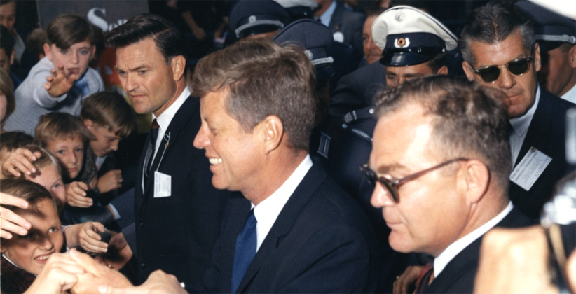 "A smiling JFK mingles with the crowd after his ""Ich bin ein Berliner"" speech. (US Army Signal Corps, JFK Library and Museum)"