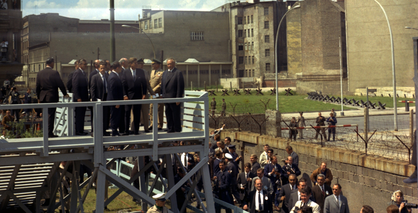 JFK looks over the Berlin Wall from a viewing platform, with a group that includes German Chancellor Konrad Adenauer. (Robert Knudsen, White House/JFK Library and Museum)
