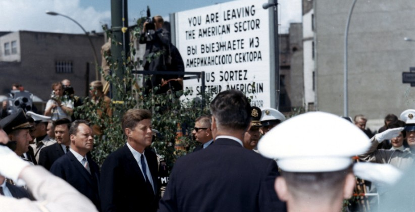 "JFK at the Berlin Wall crossing point ""Checkpoint Charlie"", with West Berlin Mayor Willy Brandt. (US Army Signal Corps, JFK Library and Museum)"