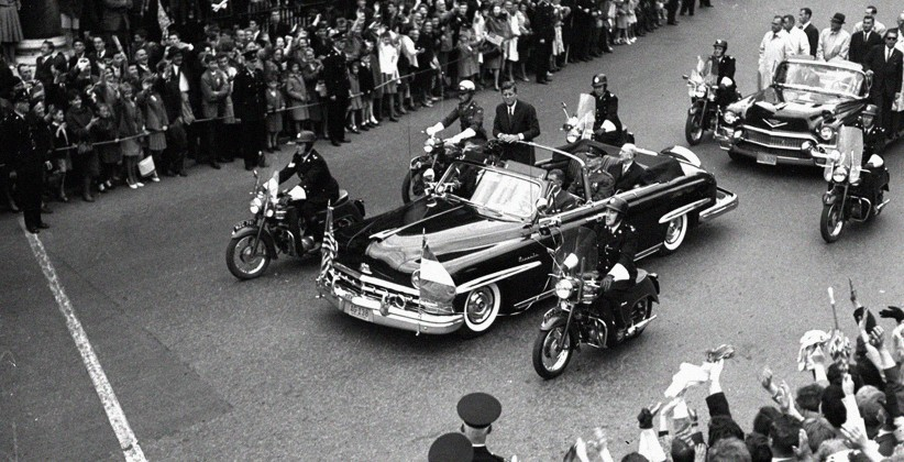 Outriders on motorcycles accompany the Presidential car as JFK travels through Dublin. (NLI, Independent Newspapers Collection)