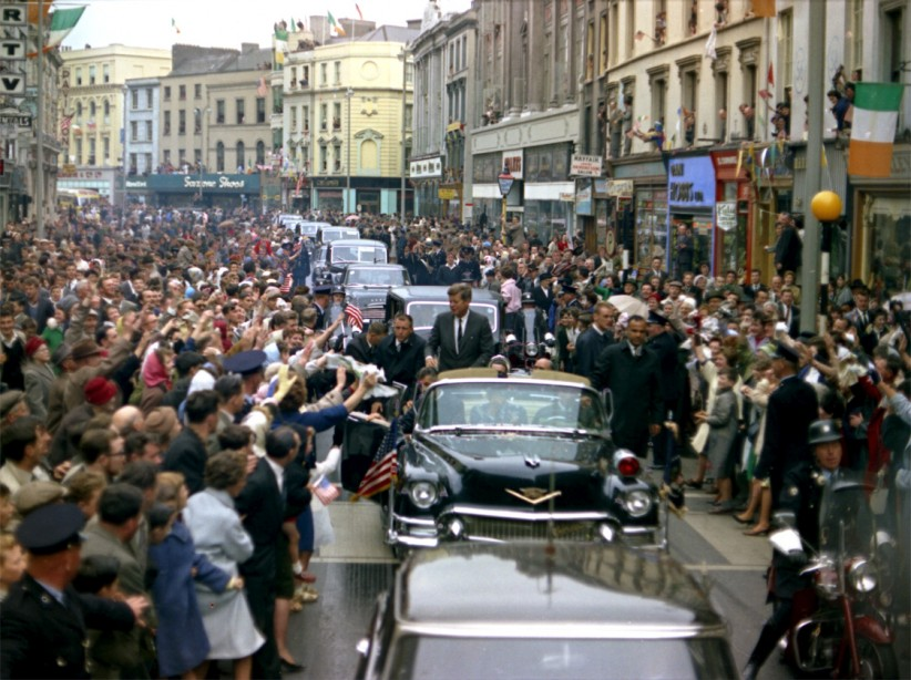 JFK is met by vast crowds in Cork. Newspapers reported that rose petals, confetti, streamers and ticker tape were thrown in the path of the cavalcade.